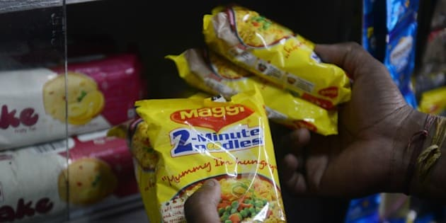 An Indian shopkeeper arranges packets of Nestle 'Maggi' instant noodles from the shelves in his shop in Siliguri on June 5, 2015. India's food safety regulator on June 5 banned the sale and production of Nestle's Maggi instant noodles over a health scare after tests found they contained excessive lead levels. AFP PHOTO/Diptendu DUTTA        (Photo credit should read DIPTENDU DUTTA/AFP/Getty Images)