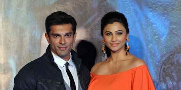 Indian Bollywood actors Karan Singh Grover and Daisy Shah pose during the trailer launch of the upcoming Hindi film 'Hate Story 3' directed by Vishal Pandya in Mumbai on October 16, 2015. AFP PHOTO        (Photo credit should read STR/AFP/Getty Images)