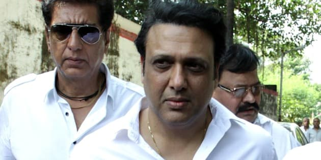 Indian Bollywood film actor Govinda attends the funeral of Bollywood film producer and director Ravi Chopra in Mumbai on November 13, 2014.  AFP PHOTO        (Photo credit should read STR/AFP/Getty Images)