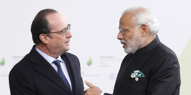 PARIS, FRANCE - NOVEMBER 30:  French President Francois Hollande (L) shakes hands with Indian Prime Minister Narendra Modi (R) as he arrives for the COP21 United Nations Climate Change Conference on November 30, 2015 in Le Bourget, France. More than 150 world leaders are meeting for the 21st Session of the Conference of the Parties to the United Nations Framework Convention on Climate Change (COP21/CMP11), from November 30 to December 11, 2015  (Photo by Chesnot/Getty Images)