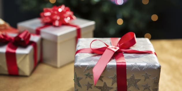 Presents in front of Christmas tree.