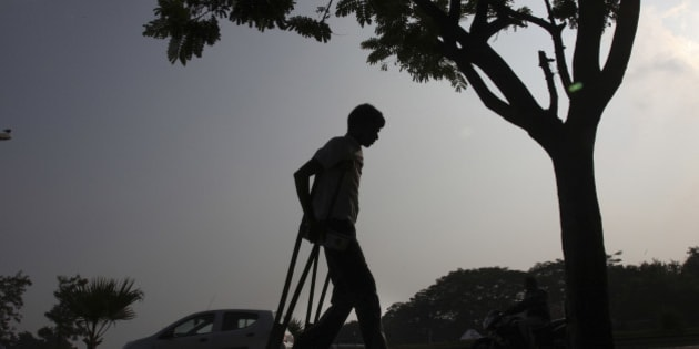 A physically disabled man returns after participating in a walk to mark the International Day of persons with Disabilities in Hyderabad, India, Tuesday, Dec. 3, 2013. According to the United Nations, over one billion people, or approximately 15 per cent of the world's population, live with some form of disability. (AP Photo/Mahesh Kumar A.)