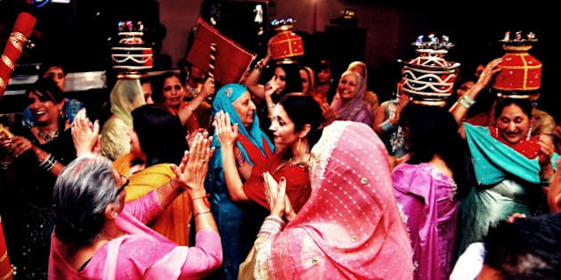 """Celebrations at a friend's <a href=""""http://www.flickr.com/search/?q=Sangeet&w=45358973@N04"""">Sangeet</a> (<a href=""""http://www.flickr.com/search/?q=Sikh&w=45358973@N04"""">Sikh</a> pre-<a href=""""http://www.flickr.com/photos/ananabanana/sets/72157623014801779/ """">wedding</a> bridal shower). Though totally broke at the time I was honoured to be able to serve as one of her photographers as my wedding gift. I hope the photos bring back happy memories for both of them for many years.  Taken with a <a href=""""http://www.flickr.com/photos/ananabanana/sets/72157623114199156/"""">Nikon D40</a> fitted with a <a href=""""http://www.flickr.com/photos/ananabanana/sets/72157624954124906/"""">Nikkor 50mm 1:1.8 AIS lens</a>. Lighting with an on-camera SB600, bounced off the ceiling. Image processed in <a href=""""http://www.flickr.com/search/?q=Photoscape&w=45358973@N04"""">Photoscape</a> in part through the application of a cinema film-filter.  More of my photos can be found <a href=""""http://www.flickr.com/photos/ananabanana/"""">here.</a>  Original filename DSC_0128-1"""