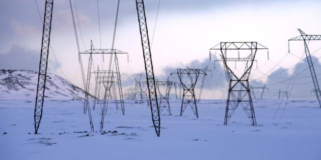 Power lines in snowy landscape