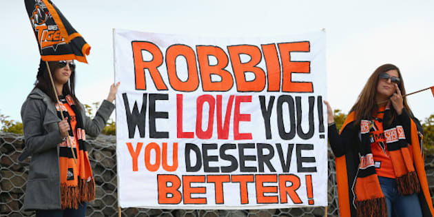 SYDNEY, AUSTRALIA - AUGUST 30:  Robbie Farah supporters in the crowd hold up a sign during the round 25 NRL match between the Wests Tigers and the New Zealand Warriors at Campbelltown Sports Stadium on August 30, 2015 in Sydney, Australia.  (Photo by Mark Kolbe/Getty Images)
