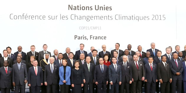PARIS, Nov. 30, 2015-- Chinese President Xi Jinping, eighth left in second row, poses for a group photo with other participants during the United Nations climate change conference in Paris, France, Nov. 30, 2015. (Xinhua/Ma Zhancheng via Getty Images)