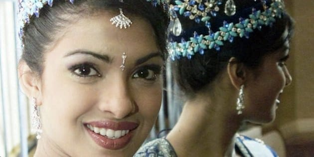 The new Miss World, India's Priyanka Chopra, 18, is reflected in a mirror during a photo session in London Friday, December 1, 2000, the morning after after she won her title.(AP Photo/Max Nash)