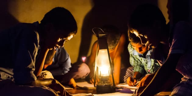 CHOWKIPUR, INDIA, - SEPTEMBER 18: Boys study by lantern light in a house L-R: (children closest to camera) Nitish Suraj (12), Ashish Choudhary (10), Baijunath Paswan (7) in Chowkipur India on September 18, 2015. Chowkipur is a village 60 KM from Patna that has no electricity. (Photo by Simon de Trey-White for the Washington Post)