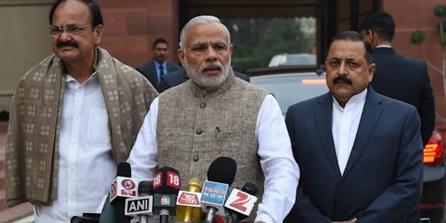 Indian Prime Minister Narendra Modi (C) stands with senior Bharatiya Janata Party (BJP) leaders as he addresses media representatives after arriving for the winter session of Parliament in New Delhi on November 26, 2015.  AFP PHOTO/ MONEY SHARMA / AFP / MONEY SHARMA        (Photo credit should read MONEY SHARMA/AFP/Getty Images)
