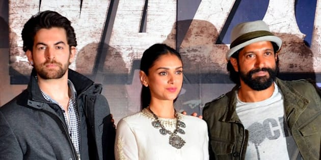 Indian Bollywood actors (L-R) Neil Nitin Mukesh, Aditi Rao Hydari and Farhan Akhtar attend the trailer launch of upcoming Hindi film 'Wazir' in Mumbai on November 18, 2015. AFP PHOTO        (Photo credit should read STR/AFP/Getty Images)
