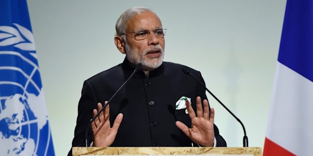 Indian Prime Minister Narendra Modi  delivers a speech during the opening day of the World Climate Change Conference 2015 (COP21), on November 30, 2015 at Le Bourget, on the outskirts of the French capital Paris. World leaders opened an historic summit in the French capital with 'the hope of all of humanity' laid on their shoulders as they sought a deal to tame calamitous climate change. AFP PHOTO / ALAIN JOCARD / AFP / ALAIN JOCARD        (Photo credit should read ALAIN JOCARD/AFP/Getty Images)