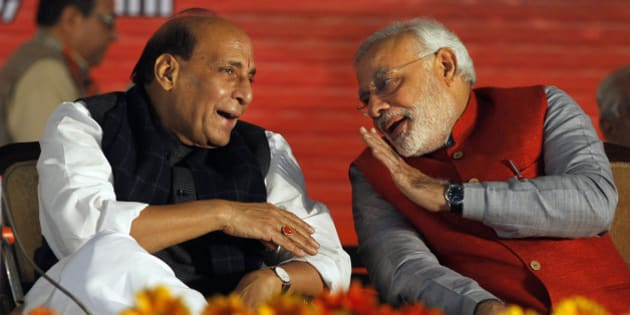 India's main opposition Bharatiya Janata Party (BJP) prime ministerial candidate Narendra Modi, right, speaks with party President Rajnath Singh during the party's two-day long National Council meeting beginning Saturday to chalk out election strategy, in New Delhi, India, Saturday, Jan. 18, 2014. Modi has been chief minister of western Gujarat state for the past 11 years and is credited with turning it into an industrial haven. Critics question whether the Hindu nationalist chief can be a truly secular leader over India's many cultures. (AP Photo/Altaf Qadri)