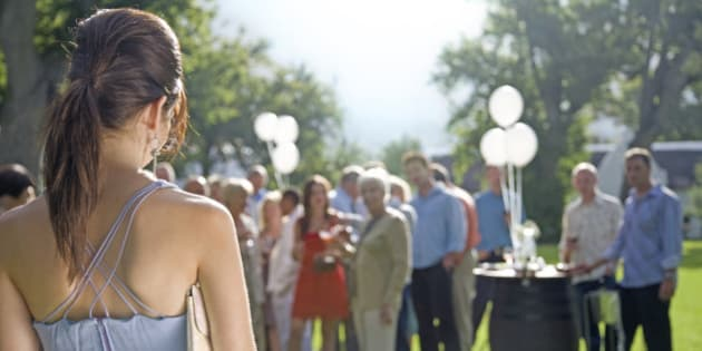 A young woman arriving at a summer garden party