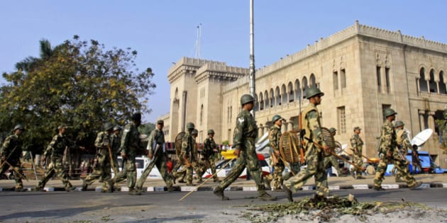 Police march past in Osmania University campus during a strike in Hyderabad, India, Monday, Dec. 7, 2009. News reports say normal life remained paralyzed in Telangana region of Andhra Pradesh state on Monday for the second successive day of the 48-hour shutdown called by the Telangana Rashtra Samiti demanding a separate state of Telangana. (AP Photo/Mahesh Kumar A)