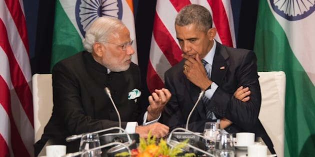 US President Barack Obama (R) talks with Indian Prime Minister Narendra Modi during a meeting at the UN conference on climate change COP21 on November 30, 2015 at Le Bourget, on the outskirts of the French capital Paris. More than 150 world leaders are meeting under heightened security, for the 21st Session of the Conference of the Parties to the United Nations Framework Convention on Climate Change (COP21/CMP11), also known as ìParis 2015î from November 30 to December 11. AFP PHOTO / JIM WATSON / AFP / JIM WATSON        (Photo credit should read JIM WATSON/AFP/Getty Images)