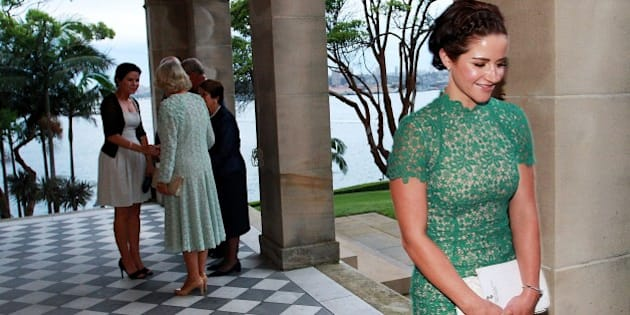 Melbourne Cup winning jockey Michelle Payne (R) smiles after meeting Britain's Camilla, Duchess of Cornwall (2nd L) at Admiralty House in Sydney on November 12, 2015.  Prince Charles and his wife Camilla are on a two-week tour of New Zealand and Australia.  AFP PHOTO / POOL / LISA MAREE WILLIAMS        (Photo credit should read Lisa Maree Williams/AFP/Getty Images)