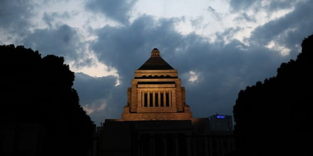 The National Diet building is illuminated during dusk in Tokyo on September 19, 2015 after Japan's Prime Minister Shinzo Abe's controversial security bills were passed during a session of parliament overnight. Japan's ruling coalition, led by nationalist Prime Minister Abe, pushed the laws through in the early hours of the morning after days of tortuous debate that at points descended into physical scuffles in parliament.    AFP PHOTO / Yoshikazu TSUNO        (Photo credit should read YOSHIKAZU TSUNO/AFP/Getty Images)