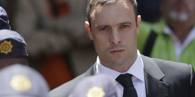 "FILE - In this Friday, Oct. 17, 2014 file photo, Oscar Pistorius is escorted by police officers as he leaves the high court in Pretoria, South Africa. A South African official says Oscar Pistorius has been released from prison and placed under house arrest. Manelisi Wolela, a spokesman for South Africa's correctional services department, said the double-amputee Olympic runner who fatally shot his girlfriend on Valentine's Day 2013 was put under ""correctional supervision"" late on Monday, Oct. 19, 2015. (AP Photo/Themba Hadebe, File)"