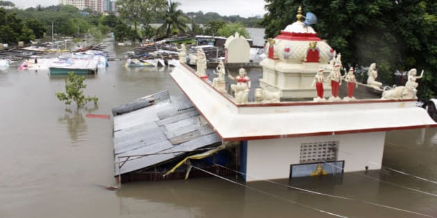 A Hindu temple is partially submerged in flood waters of an over-flowing Adyar River in Chennai, Tamil Nadu, India, Wednesday, Dec. 2, 2015. Weeks of torrential rains have forced the Chennai airport in southern India to close and have cut off several roads and highways, leaving tens of thousands of people stranded in their homes, government officials said Wednesday. (AP Photo)