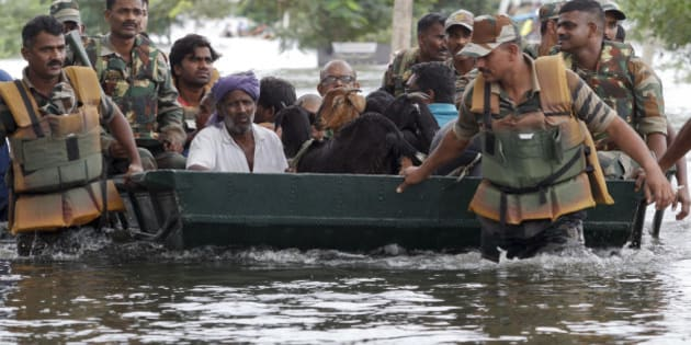 Residents and their goats are rescued by Indian army soldiers from a residential area flooded following heavy rains in Chennai, Tamil Nadu state, India, Tuesday, Nov.17, 2015. Incessant rains that lashed the city since Saturday night flooded several parts of Chennai. (AP Photo/Arun Sankar K)