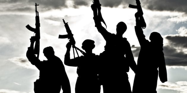 Silhouette of several muslim militants with rifles