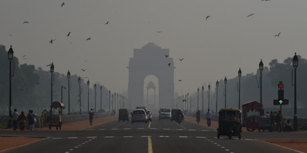 A general view showing smog enveloping New Delhi after the Diwali festival, which is notorious for heralding smoky air as thousands of firecrackers are set off, on November 12, 2015. The Indian capital has been covered in smog in late October and November 2015, blamed on farmers in neighbouring states burning stubble in their fields after the harvest and pollution from firecrackers after the Diwali festival.  AFP PHOTO / Money SHARMA        (Photo credit should read MONEY SHARMA/AFP/Getty Images)