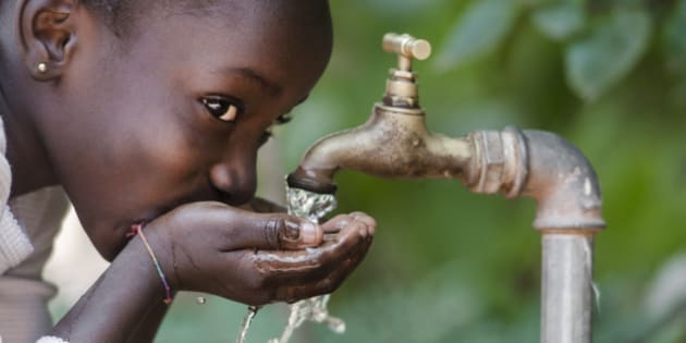 Clean Fresh Water Scarcity Symbol: Black Girl Drinking from Tap.