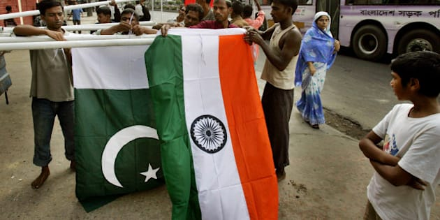 Workers erect national flags of India, front, and Pakistan as pedestrians look on in preparations for the South Asian Association for Regional Cooperation, or SAARC, summit in Dhaka, Bangladesh, Thursday, Nov. 10, 2005. Nearly 30,000 police and security forces will be deployed in the Bangladeshi capital during a twice-postponed South Asian summit scheduled here next month, officials said Wednesday. The Nov. 12-13 summit will bring together leaders of Bangladesh, India, Pakistan, Sri Lanka, Nepal, Bhutan and the Maldives to discuss economic cooperation. (AP Photo/Manish Swarup)
