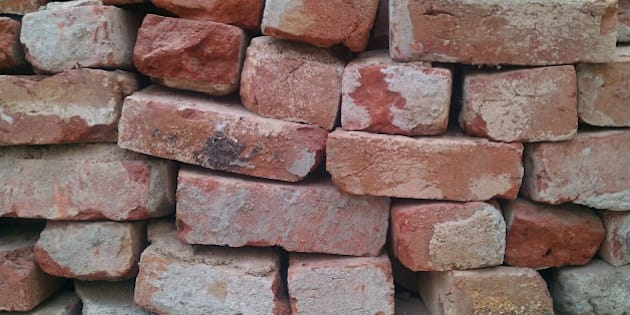 Bricks stored on top of each other, ready to be used for building.