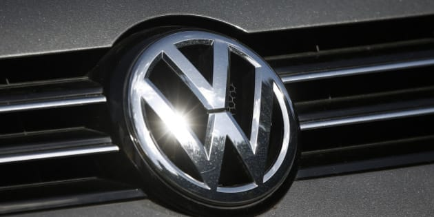 A Volkswagen AG badge sits on a car displayed on the forecourt of a dealership in London, U.K., on Wednesday, Sept. 23, 2015. Volkswagen AG's escalating scandal over emissions-test cheating is beginning to ripple across the $10 trillion global corporate bond market. Photographer: Simon Dawson/Bloomberg via Getty Images