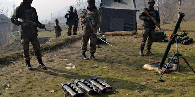 Indian army soldiers prepare to fire mortar shells towards hiding suspected militants in the Maniga area of Kupwara district north of Srinagar on November 23, 2015. A suspected rebel was killed at Maniga, near the frontier town of Kupwara in the north of the Himalayan territory, during an army search of the forested area.  AFP PHOTO / AFP / STR        (Photo credit should read STR/AFP/Getty Images)