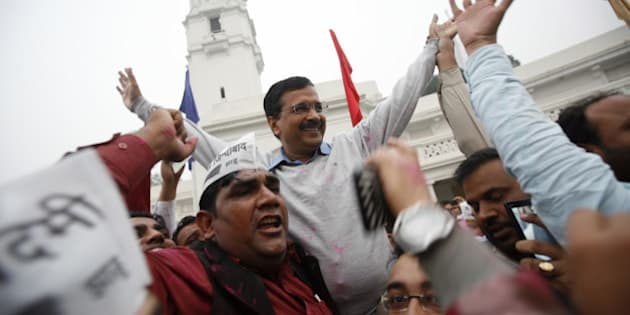NEW DELHI, INDIA - NOVEMBER 30: Delhi Chief Minister Arvind Kejriwal with AAP supporters celebrates after tabling of Jan Lokpal Bill in Delhi Assembly on November 30, 2015 in New Delhi, India. The ruling Aam Aadmi Party tabled the anti-corruption Jan Lokpal Bill in the Delhi assembly over which it had resigned in its previous 49-day tenure since the measure was blocked by the opposition. (Photo by Arun Sharma/Hindustan Times via Getty Images)
