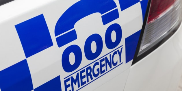 Emergency number 000 in Australia on a police car