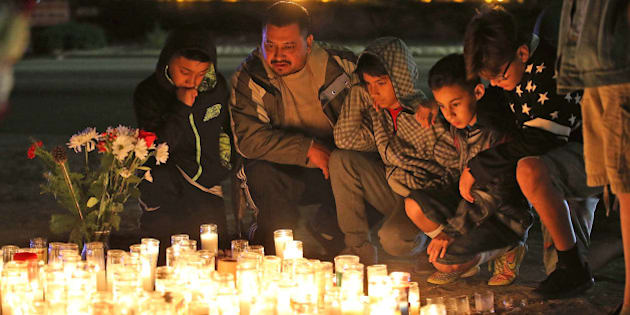 SAN BERNARDINO, CA - DECEMBER 04:  Mourners visit a makeshift memorial near the Inland Regional Center on December 4, 2015 in San Bernardino, California. The FBI has officially labeled the attack carried out by Syed Farook and his wife Tashfeen Malik as an act of terrorism. The San Bernardino community continues to mourn the attack at the Inland Regional Center in San Bernardino that left at least 14 people dead and another 21 injured.  (Photo by Justin Sullivan/Getty Images)