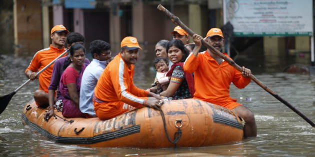 National Disaster Response Force personnel rescue people stranded in floodwaters in Chennai, in the southern Indian state of Tamil Nadu, Friday, Dec. 04, 2015. The relentless rains that lashed southern India's Tamil Nadu state for three days eased Friday, but the misery of tens of thousands of people was far from over, with large parts of the main city still underwater along with the region's biggest airport. (AP Photo/Arun Sankar K)