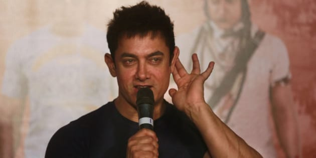 "Bollywood actor Aamir Khan gestures as he speaks to the media during the teaser launch of his upcoming film ""PK"" in Mumbai, India, Thursday, Oct 23, 2014. The movie is scheduled for release on Dec. 19. (AP Photo/Rafiq Maqbool)"