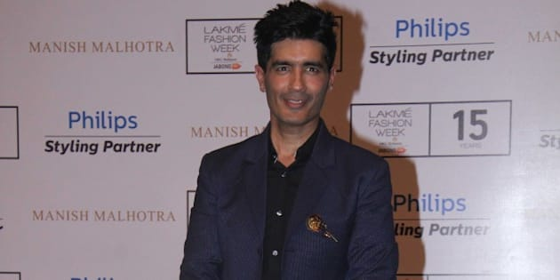 MUMBAI, INDIA - AUGUST 26: Bollywood fashion designer Manish Malhotra during the Lakme Fashion Week Winter/Festive 2015 - Day 1, on August 26, 2015 in Mumbai, India. (Photo by Pramod Thakur/Hindustan Times via Getty Images)