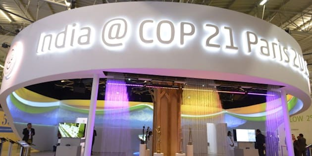 Visitors walk at the information booth of India during the COP 21 United Nations conference on climate change, on November 30, 2015 at Le Bourget, on the outskirts of the French capital Paris. More than 150 world leaders are meeting under heightened security, for the 21st Session of the Conference of the Parties to the United Nations Framework Convention on Climate Change (COP21/CMP11), also known as Paris 2015 from November 30 to December 11. AFP PHOTO / BERTRAND GUAY / AFP / BERTRAND GUAY        (Photo credit should read BERTRAND GUAY/AFP/Getty Images)