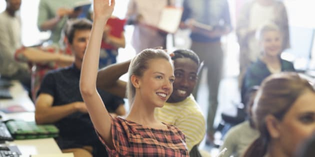 University student raising hand at IT seminar
