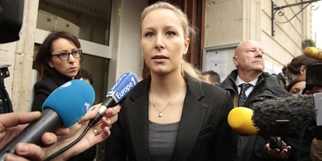 CARPENTRAS, FRANCE - DECEMBER 06:  Marion Marechal-Le Pen vice President of the French far-right Front National (FN) party and candidate for the regional elections in the Provence-Alpes-Cote d'Azur (PACA) region speaks to the press as she leaves a polling station on December 6, 2015 in Carpentras, France. Voting is under way in France's regional elections, which are being held under a continued state of emergency following the Paris terror attacks.   (Photo by Patrick Aventurier/Getty Images)