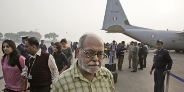 People who were stranded in Indian southern city of Chennai due to floods arrive at the Palam Airport after being evacuated by special Indian Air Force plane in New Delhi, India, Thursday, Dec. 3, 2015. The heaviest rainfall in more than 100 years has devastated swathes of the southern Indian state of Tamil Nadu, with thousands forced to leave their submerged homes, schools, offices and a regional airport shut for a second day Thursday. (AP Photo/Manish Swarup)