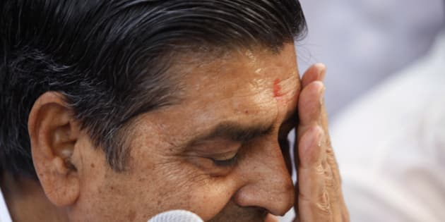 Congress party leader Jagdish Tytler reacts as he holds a press conference to announce his decision to not contest in the upcoming elections in New Delhi, India, Thursday, April 9, 2009. There have been huge protests from the Sikh community and the Home Minister Palaniappan Chidambaram was recently thrown a shoe by a Sikh journalist after Congress party fielded Tytler and Sajjan Kumar as candidates, who are allegedly believed to have instigated mobs to riot against the Sikh community, after the death of former Indian Prime Minister Indira Gandhi.  (AP Photo/Saurabh Das)