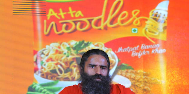 NEW DELHI, INDIA  NOVEMBER 16:  Baba Ramdev launching Patanjali Atta Noodles on November 16, 2015 in New Delhi, India. Baba Ramdev-promoted Patanjali launched its whole wheat instant noodles, just a week after product leader Nestle's Maggi re-hit the retail shelves after a five-month ban imposed by the food-safety regulator.(Photo by Vipin Kumar/Hindustan Times via Getty Images)