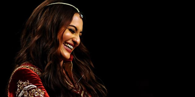 Indian Bollywood actress Sonakshi Sinha showcases a creation by designer JJ Valaya during the Blenders Pride Fashion Tour 2015 in Mumbai late December 4, 2015. AFP PHOTO/Sujit Jaiswal / AFP / SUJIT JAISWAL        (Photo credit should read SUJIT JAISWAL/AFP/Getty Images)
