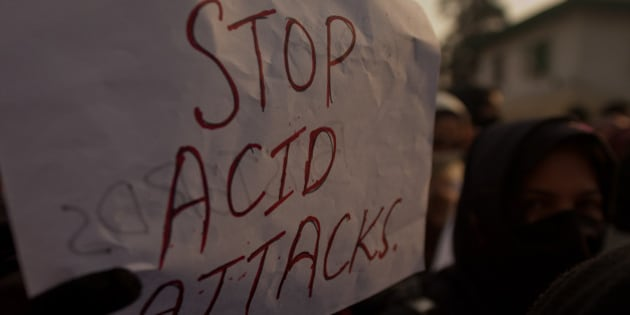 SRINAGAR, KASHMIR, INDIA - DECEMBER 12: A Kashmir law student holds a placard during a protest against acid attack  on December 12, 2014 in Srinagar, the summer capital of Indian administered Kashmir, India. Dozens of Kashmiri law students held a protest in the Muslim majority state of Kashmir demanding  immediate arrest and stringent punishment to the acid attackers involved in yesterday's acid attack on a law student that left her in a critical condition.  A 21-year-old Law student was injured Thursday in an acid attack by unidentified car-borne youth outside her college in Srinaga the summer capital, police said. (Photo by Yawar Nazir/Getty Images)