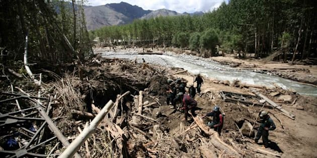 LEH, INDIA � AUGUST 10 : Rescue team looking for dead bodies near Phyang village in Leh. Flash floods have killed 156 people and At least 300 people remained missing from last week's floods triggered by heavy rains that destroyed homes and architecture. (Photo by Shekhar Yadav/India Today Group/Getty Images)