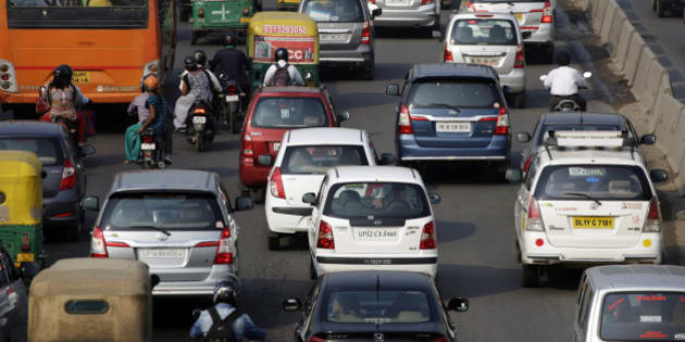Traffic moves along a highway during morning rush hour in Delhi, India, on Oct 29, 2015. India in October was the last major nation to submit its approach to tackling emissions ahead of a landmark UN climate change conference in December, pledging to cut their intensity about a third by 2030 from 2005 levels. Photographer: Kuni Takahashi/Bloomberg via Getty Images