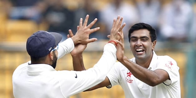 BENGALURU, INDIA - NOVEMBER 14: Indian cricket team player Ravichandran Ashwin and Captain Virat Kohli celebrate the dismissal of South African player Faf du Plessis during the 2nd Test match between India and South Africa at M. Chinnaswamy Stadium on November 14, 2015 in Bengaluru, India. (Photo by Ajay Aggarwal/Hindustan Times via Getty Images)