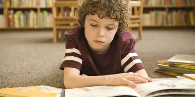 Boy studying in library