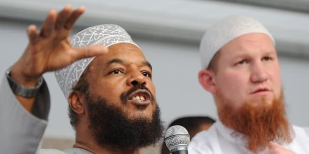 Controversial German Islamist preacher Pierre Vogel (R) and Abu Ameenah Bilal Philips, an Islamic scholar criticised as hate preacher, speak to their supporters during a demonstration on April 20, 2011 in Frankfurt/M., western Germany. Vogel, also known as Abu Hamza, had called for the demonstration titled 'Islam - the misunderstood religion'.    AFP PHOTO    ARNE DEDERT    GERMANY OUT (Photo credit should read ARNE DEDERT/AFP/Getty Images)